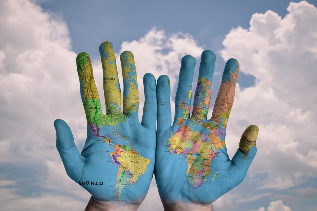creative paiting of the world on hands