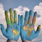 paiting of the world on hands